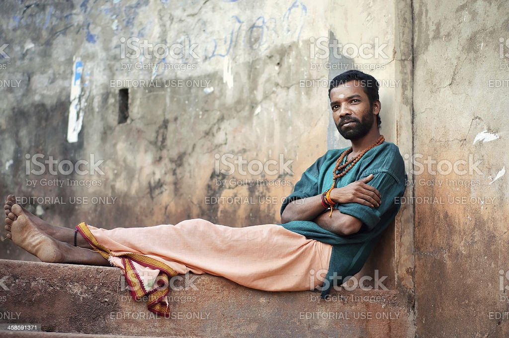 Indian man sitting on the stairs. stock photo