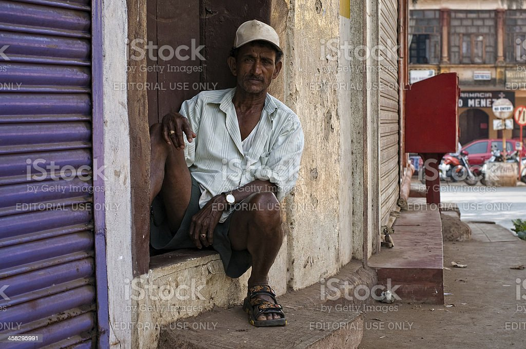 Indian man sitting on the street royalty-free stock photo