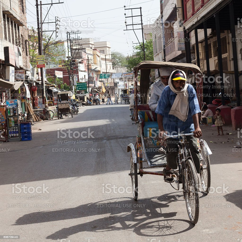 Indian Man Transporting Passengers With His Cycle Rickshaw stock photo