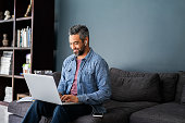 istock Indian man typing on laptop while working from home 1319763709