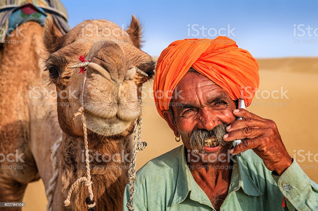 Indian man using a mobile, desert village, India stock photo