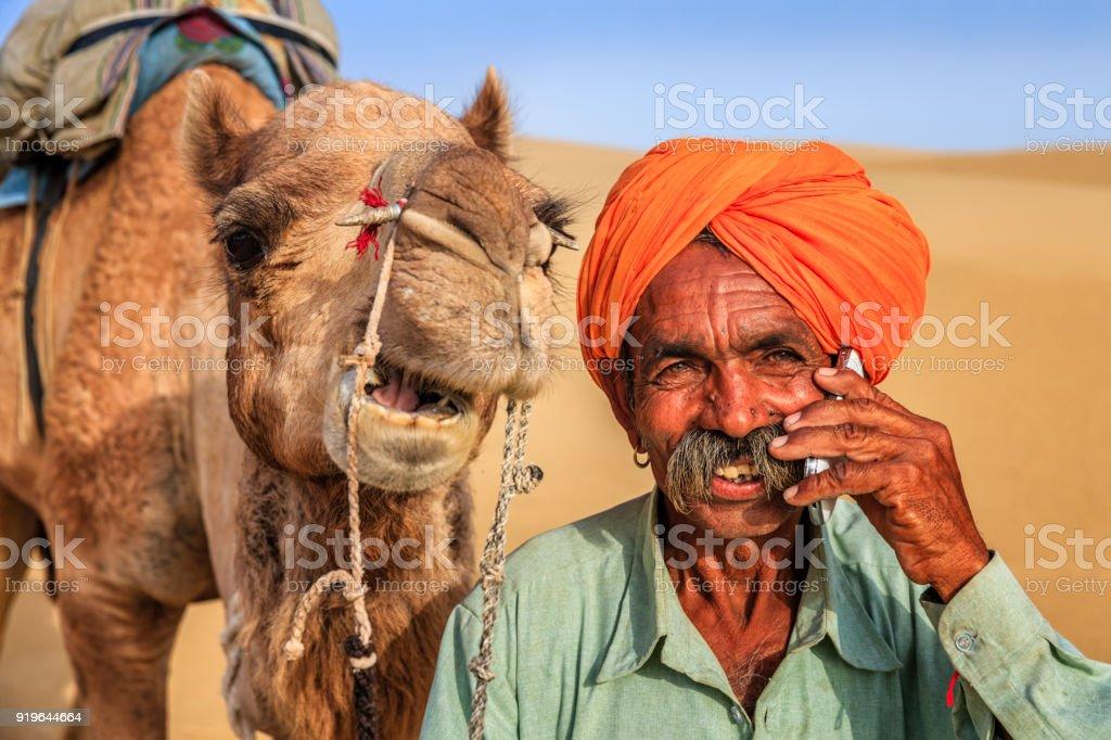 Indian man using a mobile, desert village, India stock photo