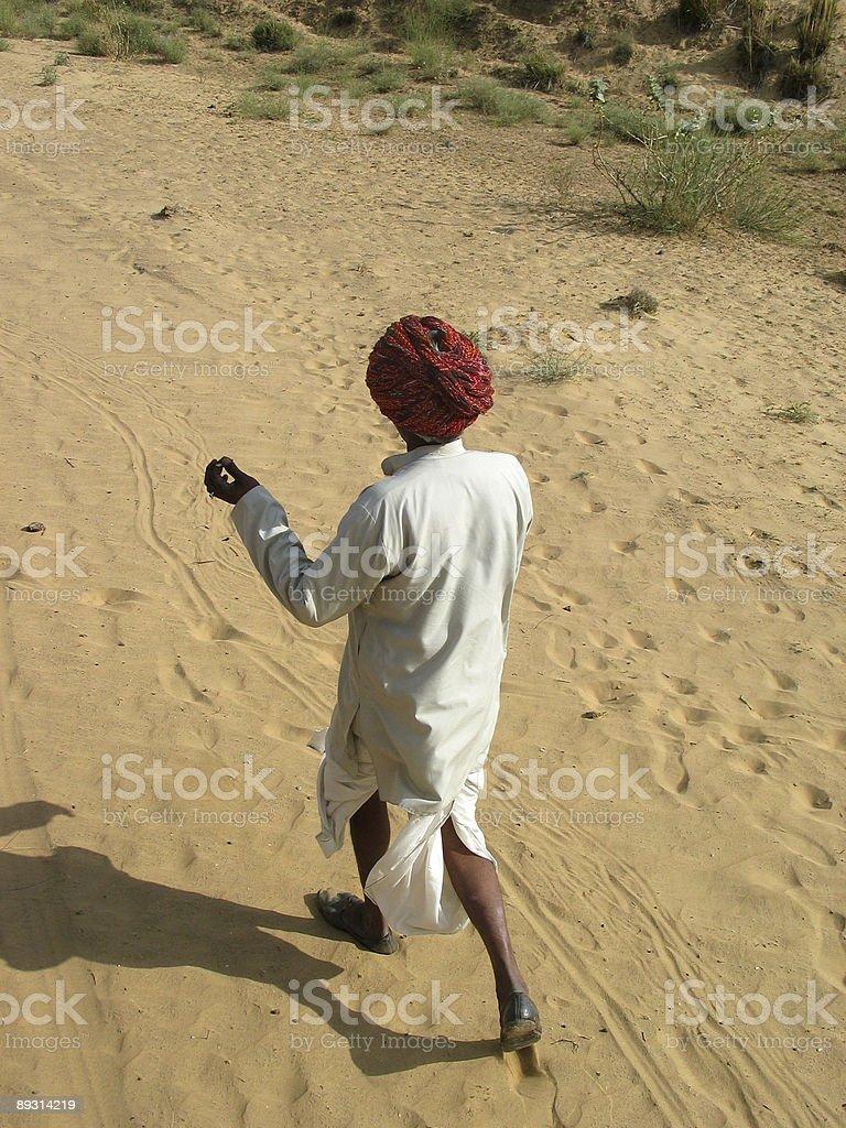 Indian man walking in Tzar desert royalty-free stock photo