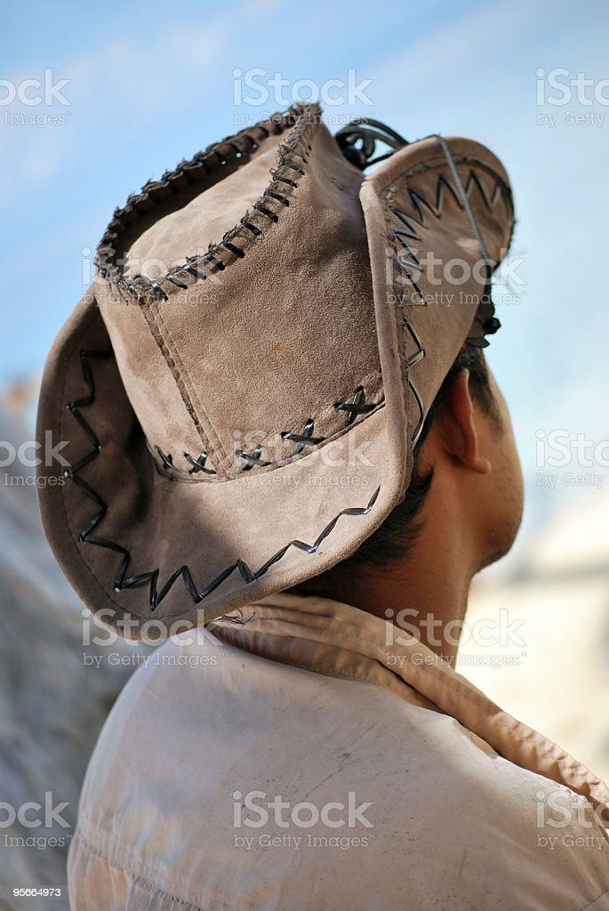 indian man wearing hat, waiting at beach royalty-free stock photo