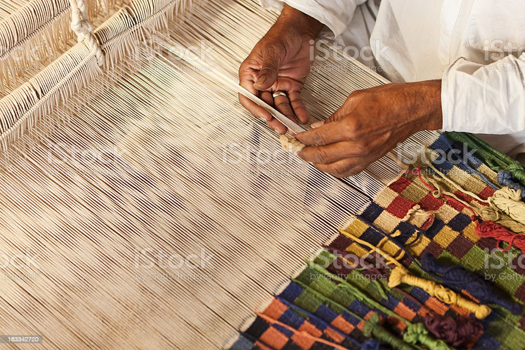 Indian man weaving textiles (durry). Salawas village. Rajasthan. stock photo
