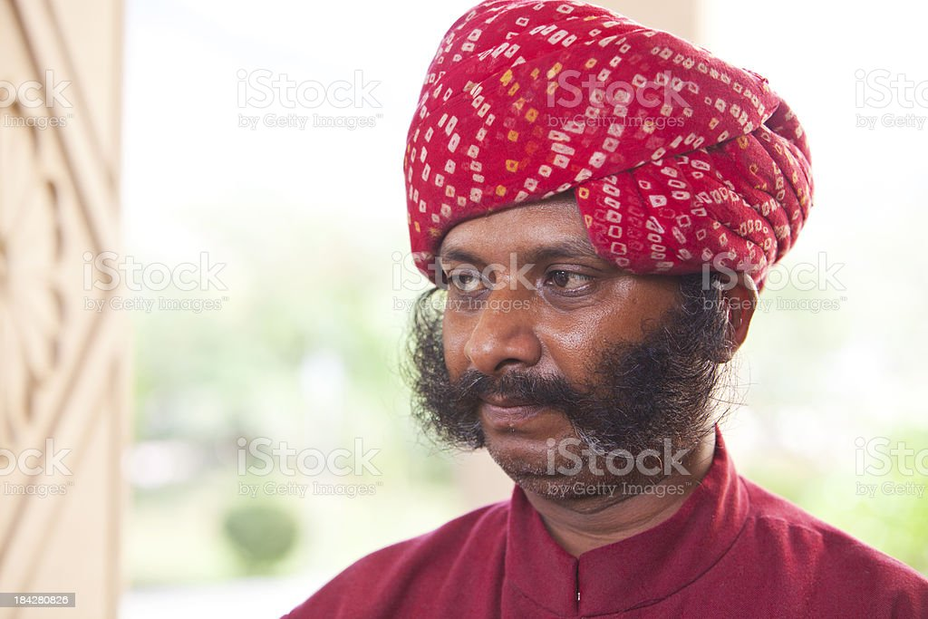 Indian man with impressive sideburns and red turban. stock photo