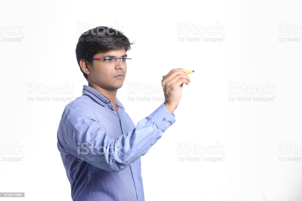 indian man with marker pen and writing stock photo