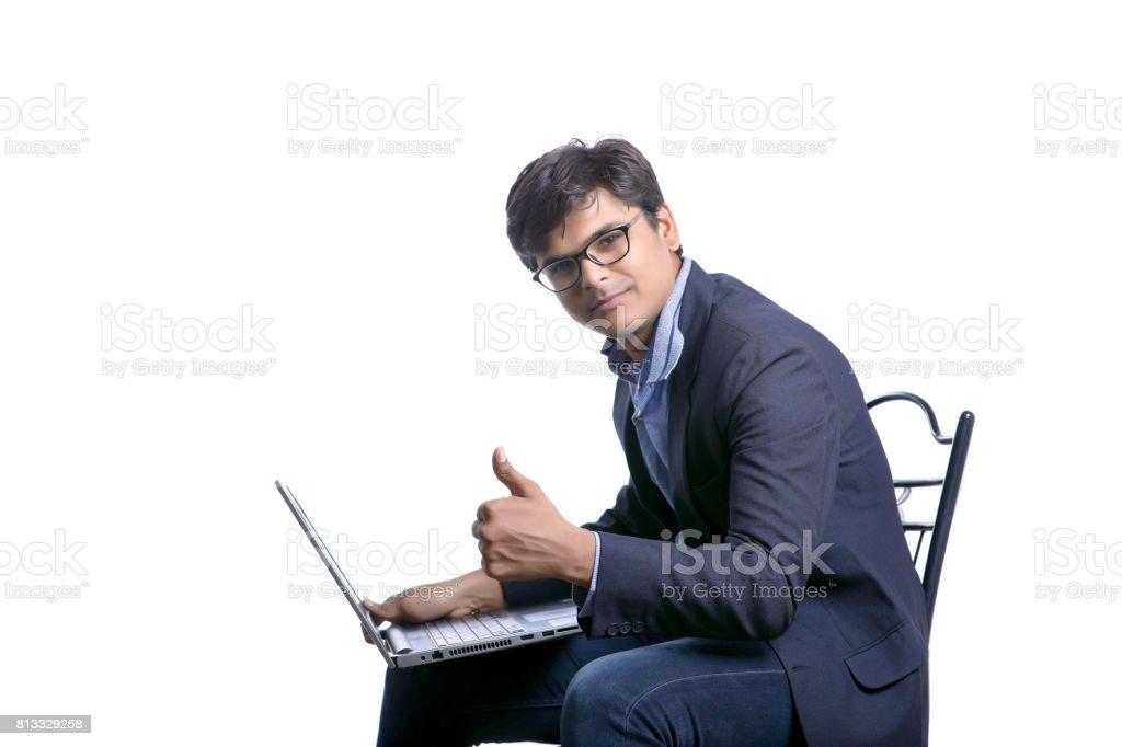 indian man working on laptop stock photo