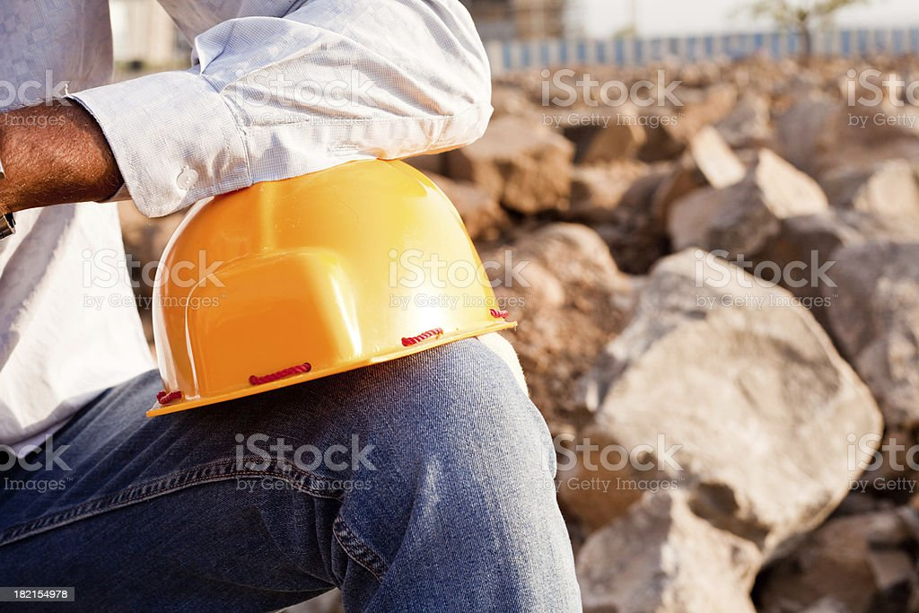 Indian Manual Worker Engineer Holding a Safety Helmet royalty-free stock photo