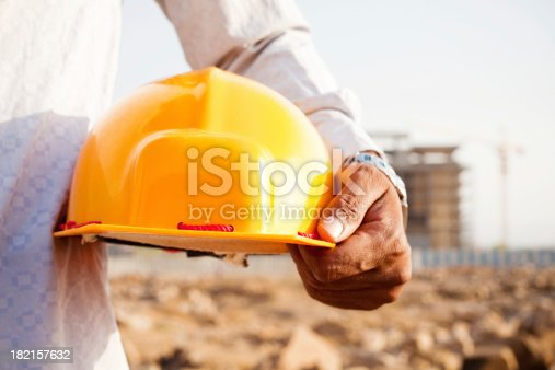 1047558948istockphoto Indian Manual Worker Engineer Holding a Safety Helmet 182157632
