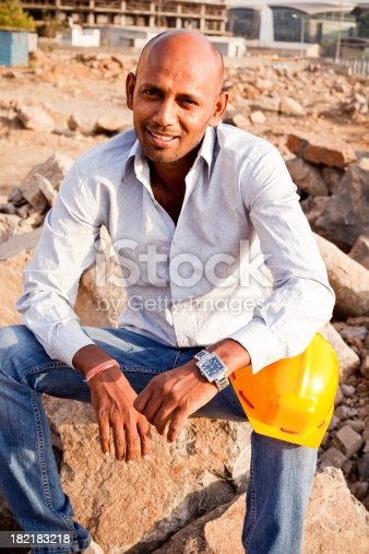 1047558948istockphoto Indian Manual Worker Engineer Holding a Safety Helmet 182183218