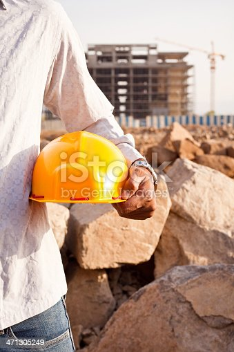 1047558948istockphoto Indian Manual Worker Engineer Holding a Safety Helmet 471305249