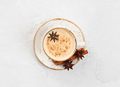 istock Indian Masala chai tea. Traditional Indian hot drink with milk and spices on white concrete background. 1192562108
