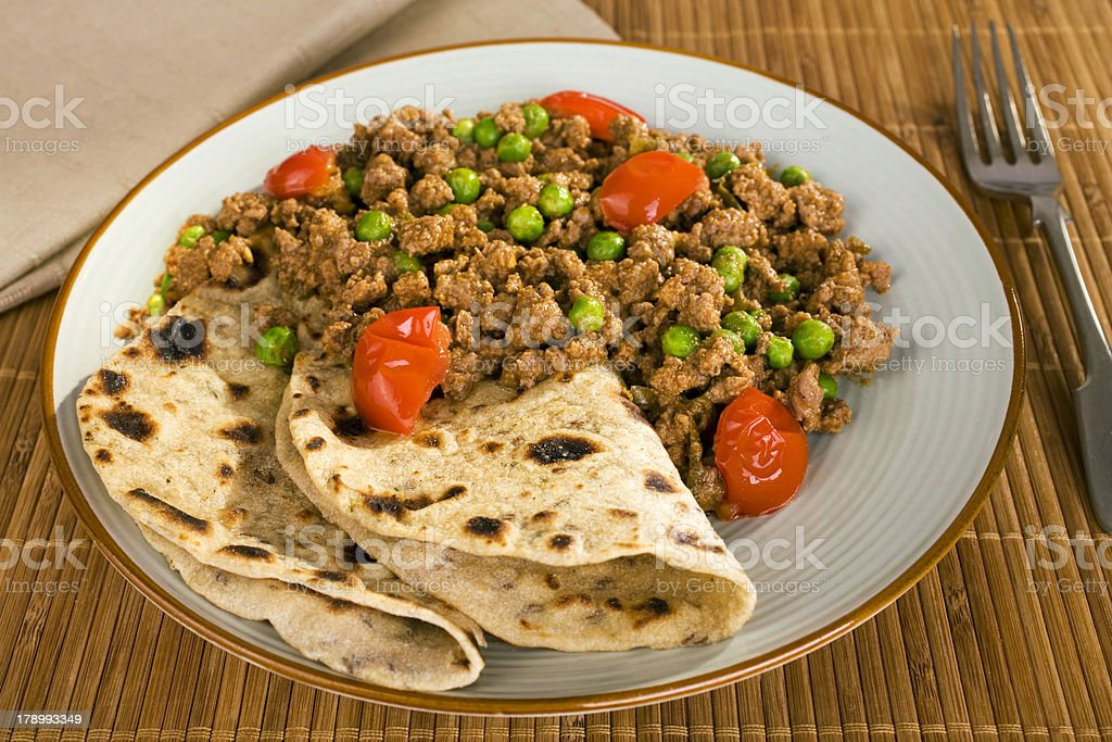 Indian Meal Food Cuisine Lamb Keema Curry with Peas Chapati royalty-free stock photo