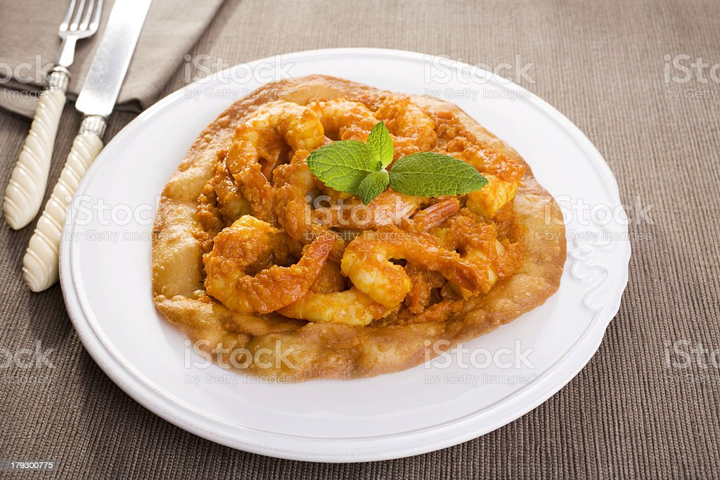 Indian Meal Food Cuisine Prawn Curry on Puri royalty-free stock photo