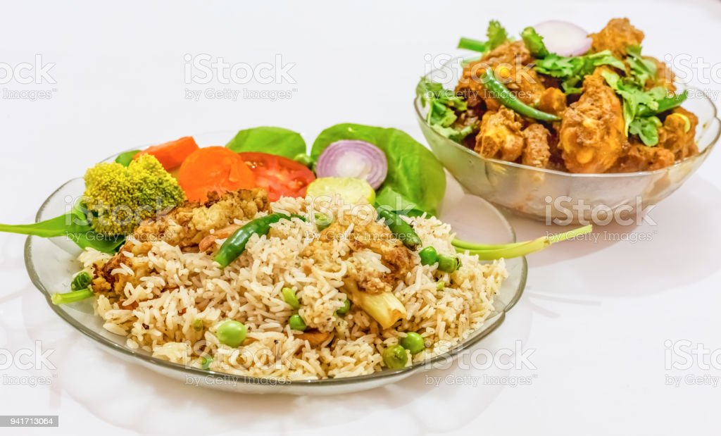 Indian Meal Of Vegetable Fried Rice And Spicy Chicken Meat