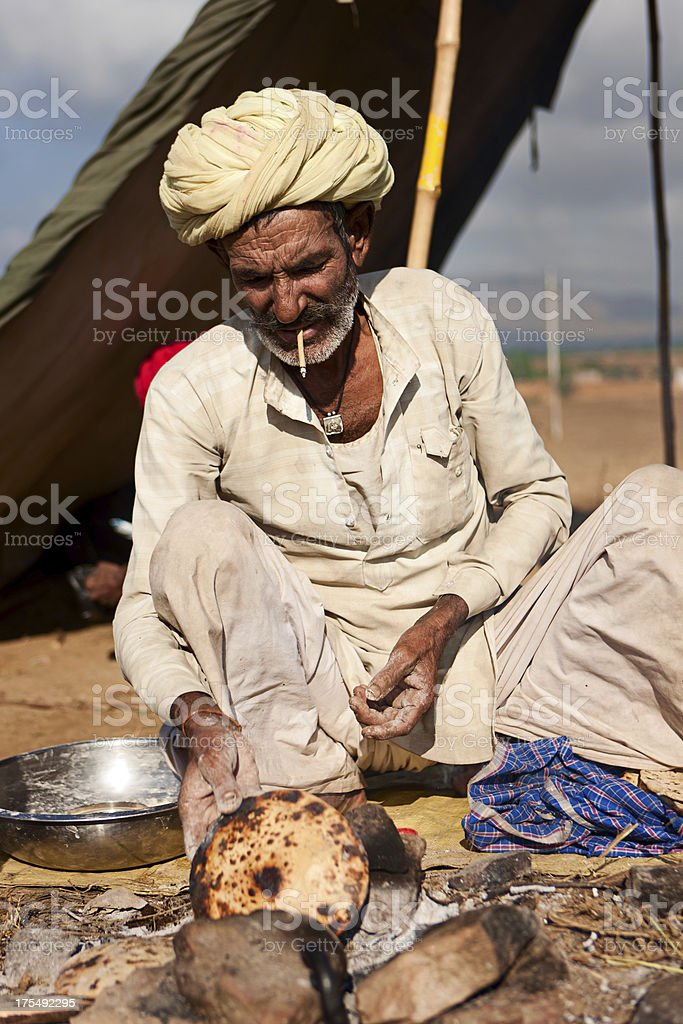 Indian men preparing chapatti bread during festival in Pushkar royalty-free stock photo
