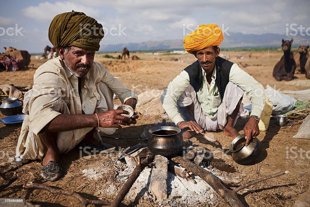 Indian men setting up the fire during camel festival. Pushkar stock photo