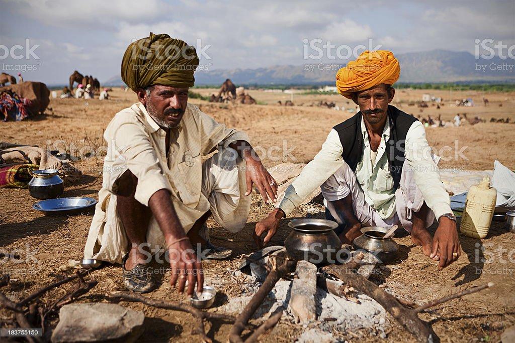 Indian men setting up the fire during camel Pushkar festival stock photo