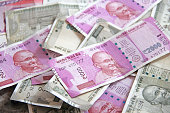 istock Indian money and banknotes, 500 rupees and 2,000 rupees. Background of paper Indian money 1081455534