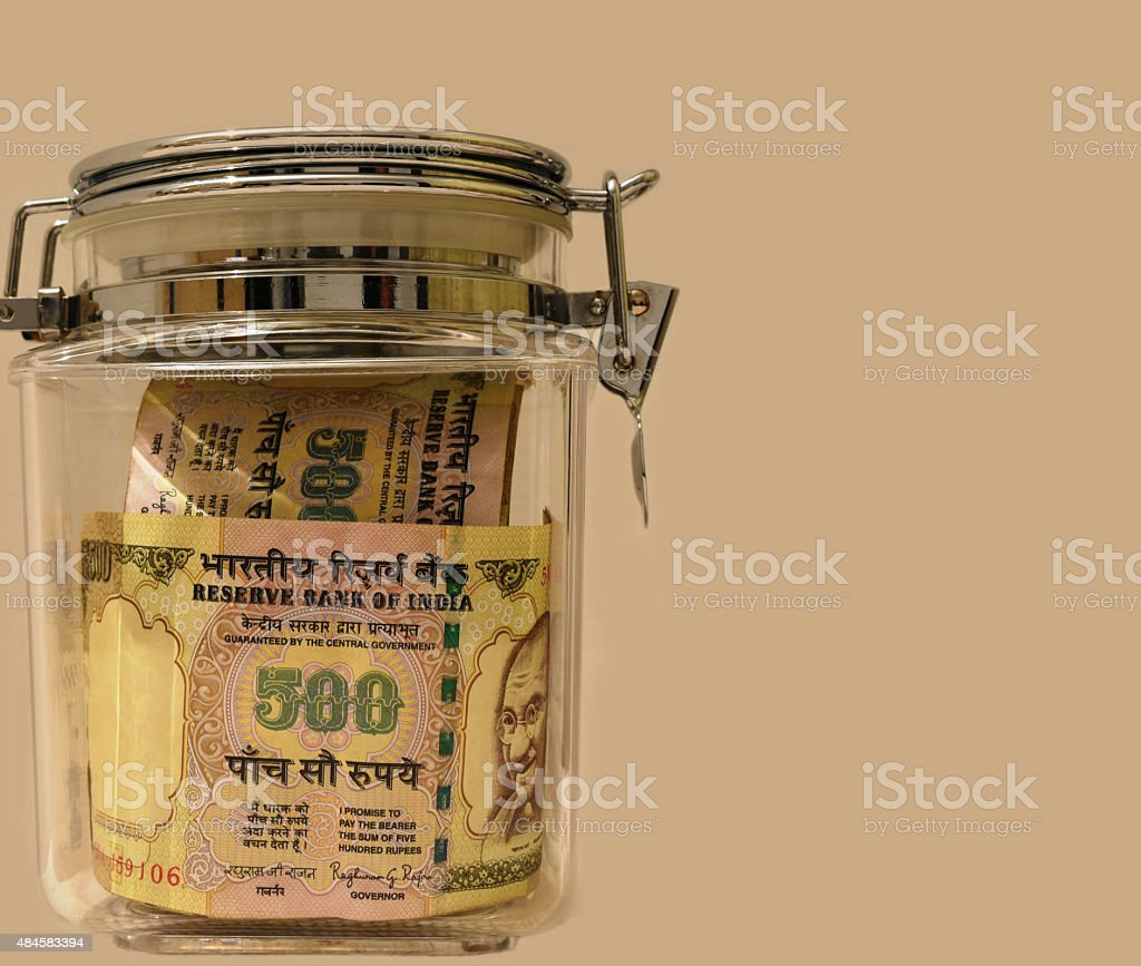 Indian Money in locked jar stock photo