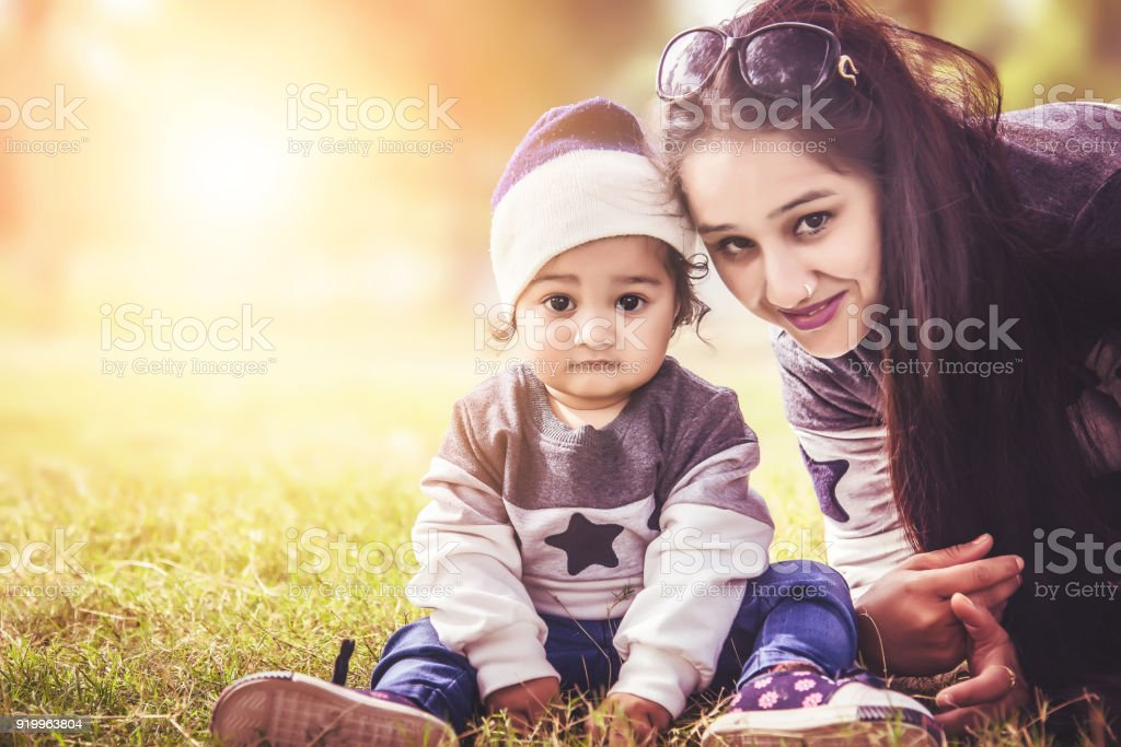 Indian Mother And Child Little Daughter Stock Photo - Download Image