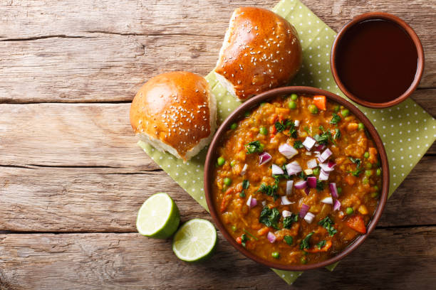 Indian Mumbai food Pav bhaji from vegetables with bread close-up in a bowl. horizontal top view stock photo