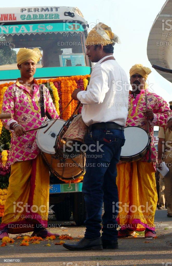 Indian Musicians play drums in sikh Nagar Keertan,Traditional procession on birthday of Guru Nanak stock photo