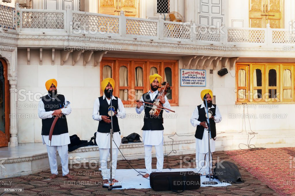 Indian musicians playing local instruments in Golden Temple stock photo
