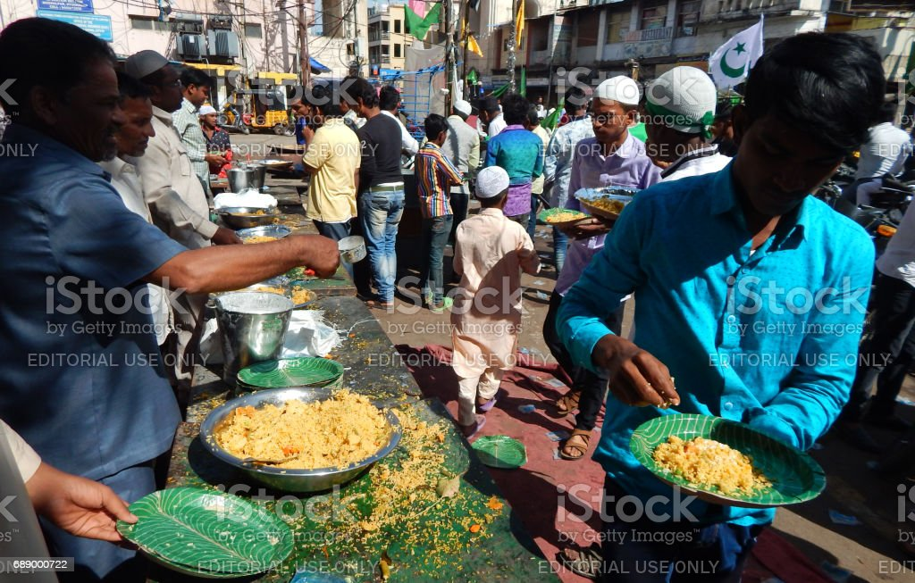 Indian Muslims distribute the public food a ritual on Milad un Nabi birthday of Prophet Mohammed, Hyderabad,India. stock photo
