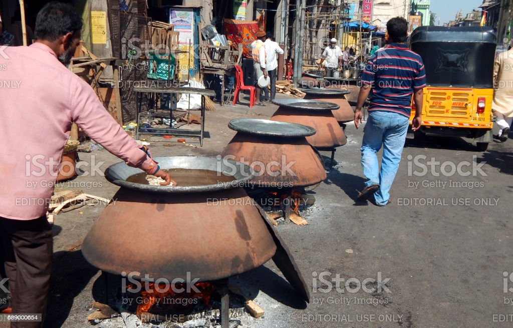 Indian Muslims prepare food for public distribution on Milad un Nabi birthday of Prophet Mohammed, Hyderabad,India. stock photo