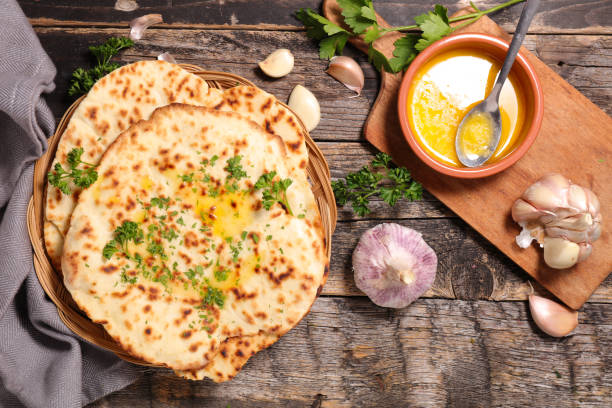 indian naan bread indian naan bread naan bread stock pictures, royalty-free photos & images