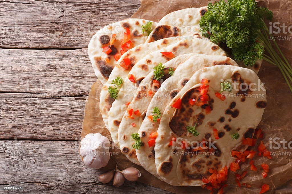 Indian Naan flat bread with garlic and herbs. top view stock photo