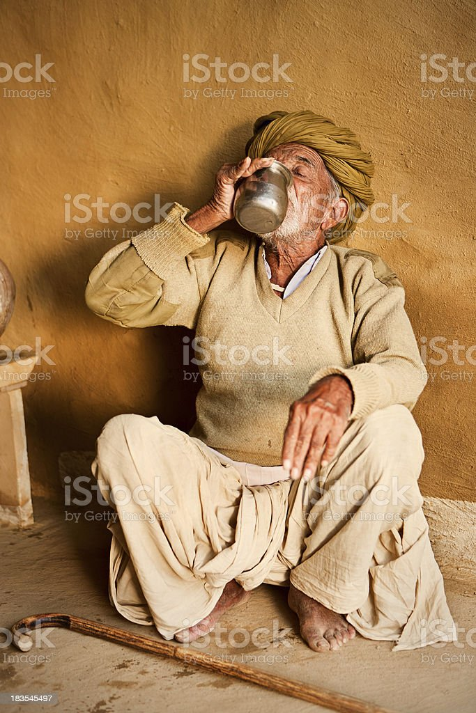 Indian old man drinking cold water royalty-free stock photo