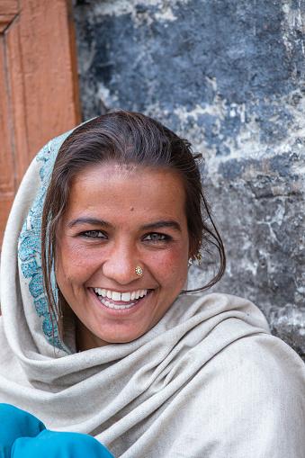 Leh, India - june 24, 2015 : Indian happy girl on the street market in mountain village Leh, Ladakh region, north India, close up