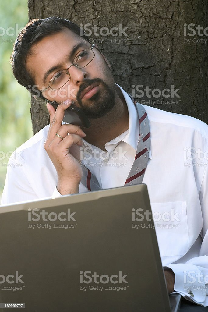 Indian on a phone royalty-free stock photo