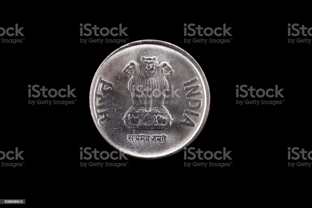 Indian one rupee coin close up on black stock photo