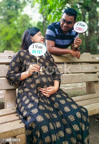 istock Indian parents posing for baby shower photo shoot with various props 1196818813