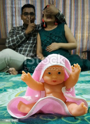 istock Indian parents posing for baby shower photo shoot with various props 1196819460