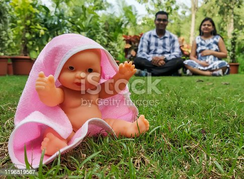 istock Indian parents posing for baby shower photo shoot with various props 1196819567