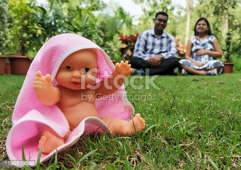 istock Indian parents posing for baby shower photo shoot with various props 1196819568