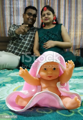istock Indian parents posing for baby shower photo shoot with various props 1196819720