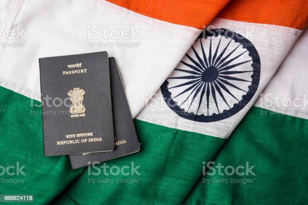 Indian passport and authentic indian tricolour flag made up of khadi picture id666624118?b=1&k=6&m=666624118&s=612x612&h=qsz19eabaa3zmmfte3dqx dl7zmnt4mqmd1i5tttmu0=