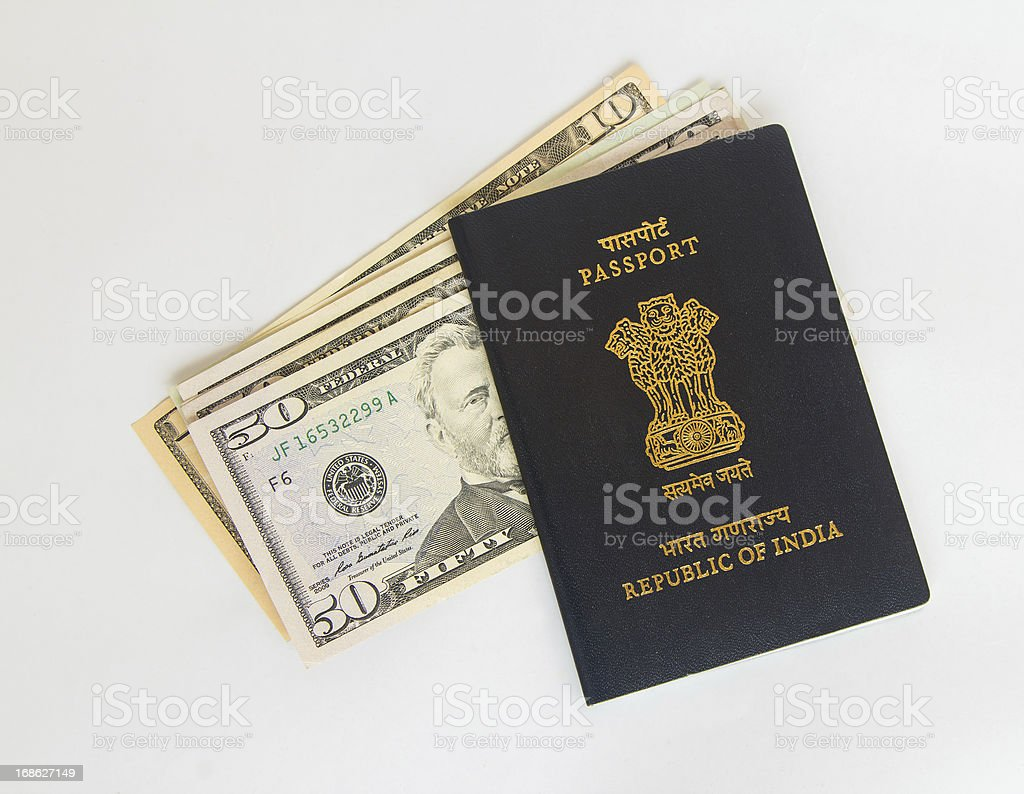 Indian passport and US currency stock photo