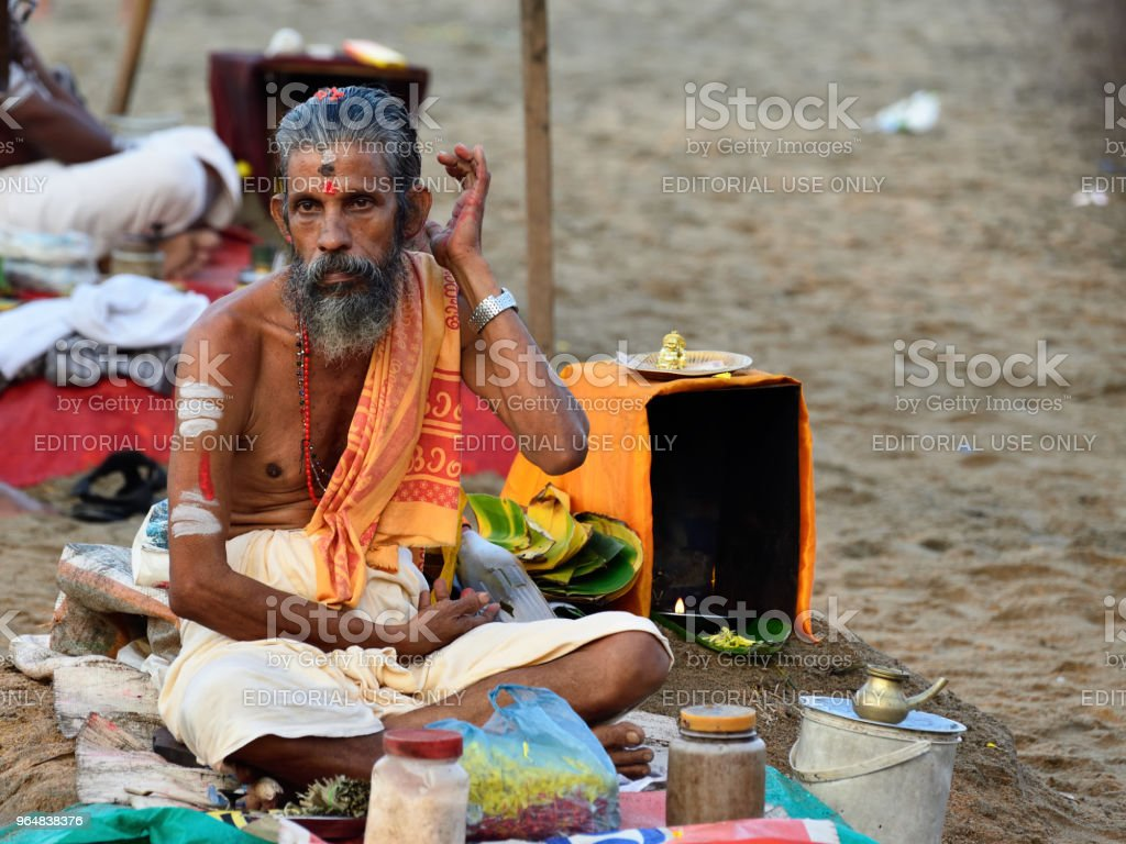 Indian people performing puja royalty-free stock photo