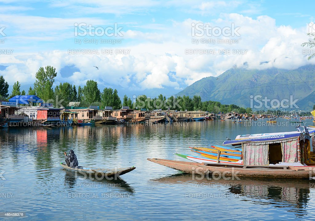 Indian people rowing the traditional boat in Dal lake, Srinagar stock photo
