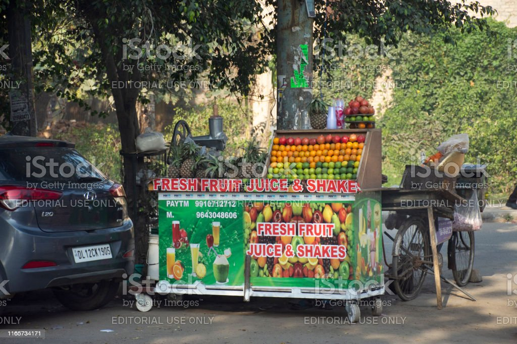 Indian people sale and buy juice shake fruits vegetables from small...