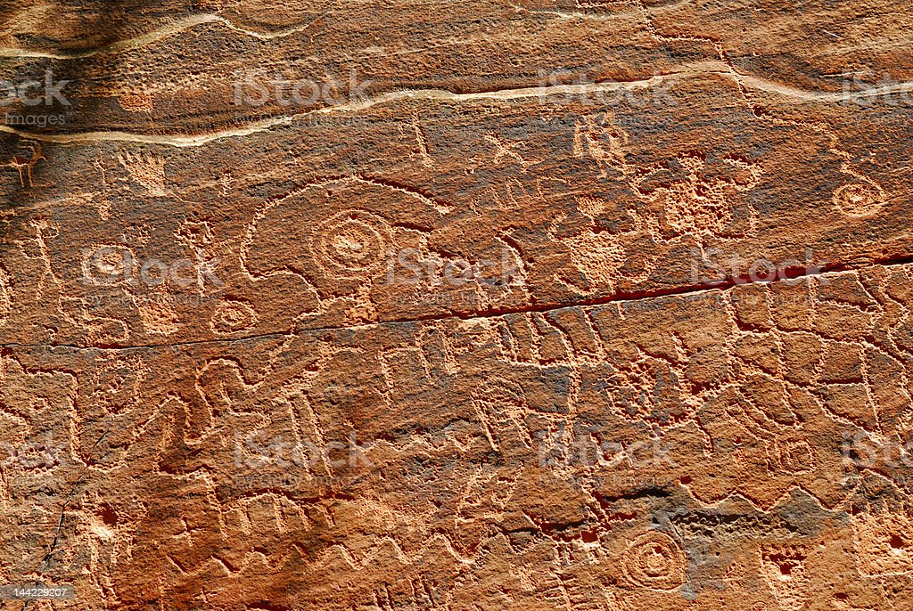Indian petroglyphs on red rock royalty-free stock photo