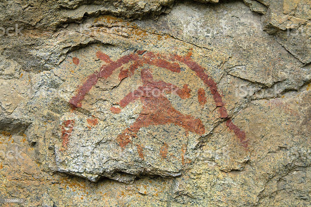 Indian Pictograph on a granite cliff face. royalty-free stock photo
