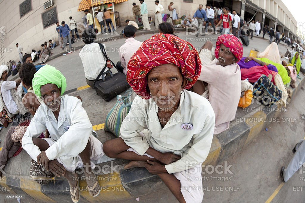 Indian pilgrim waiting for train in New Delhi Railway Station royalty-free stock photo